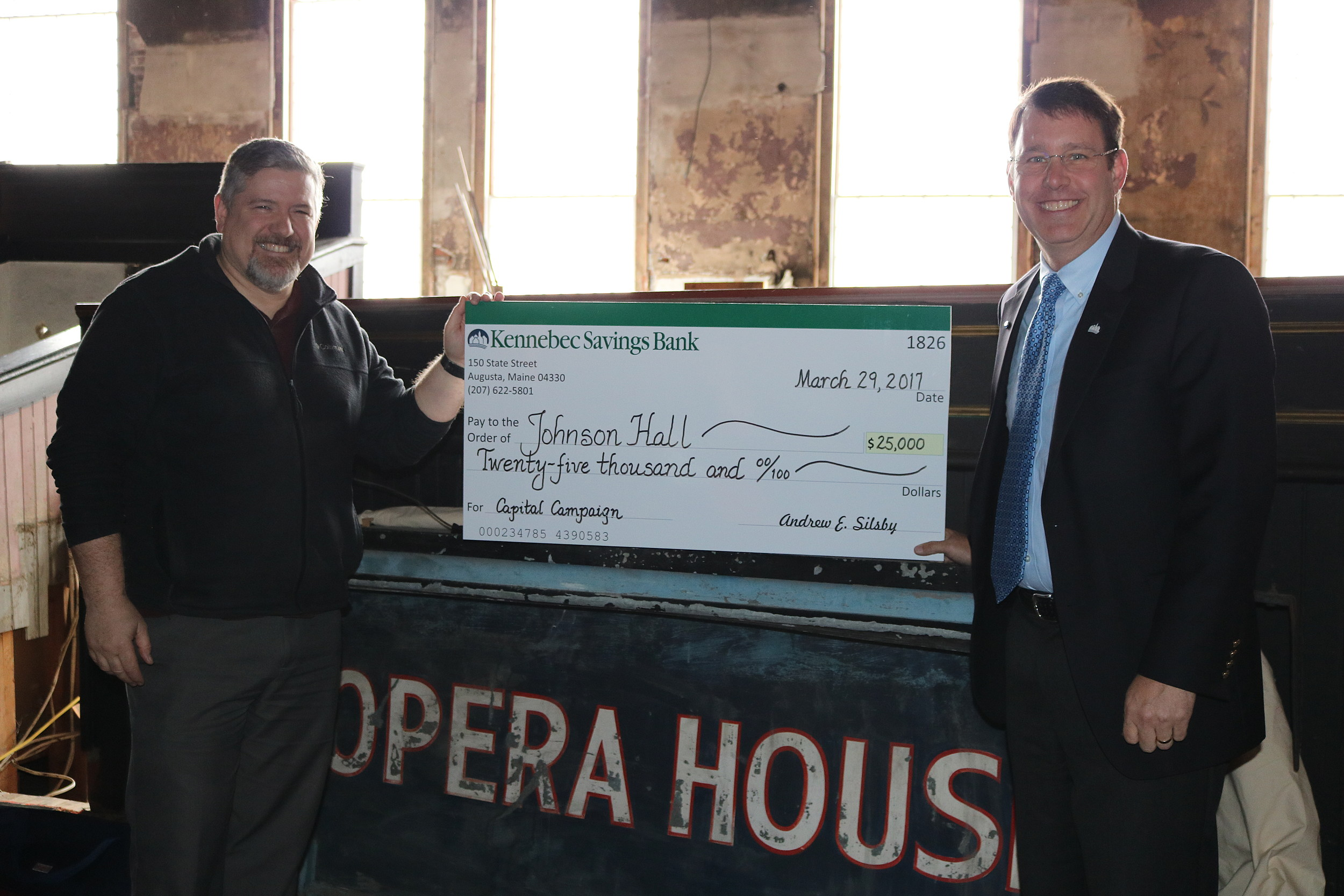 Kennebec Savings Bank President presents Johmson Hall with a check for $25K. Photo courtesy of Johnson Hall