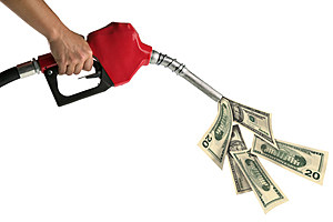 Hand with gas pump and money